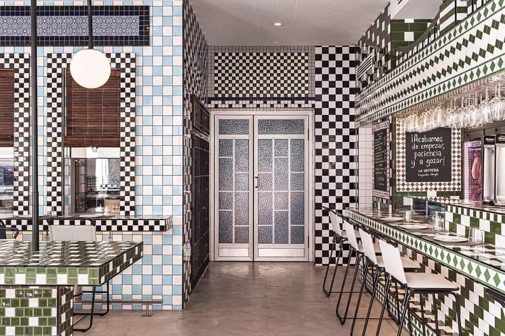 This is a close look at the restaurant that is dominated by the different tones of checkered tiled walls and countertops.