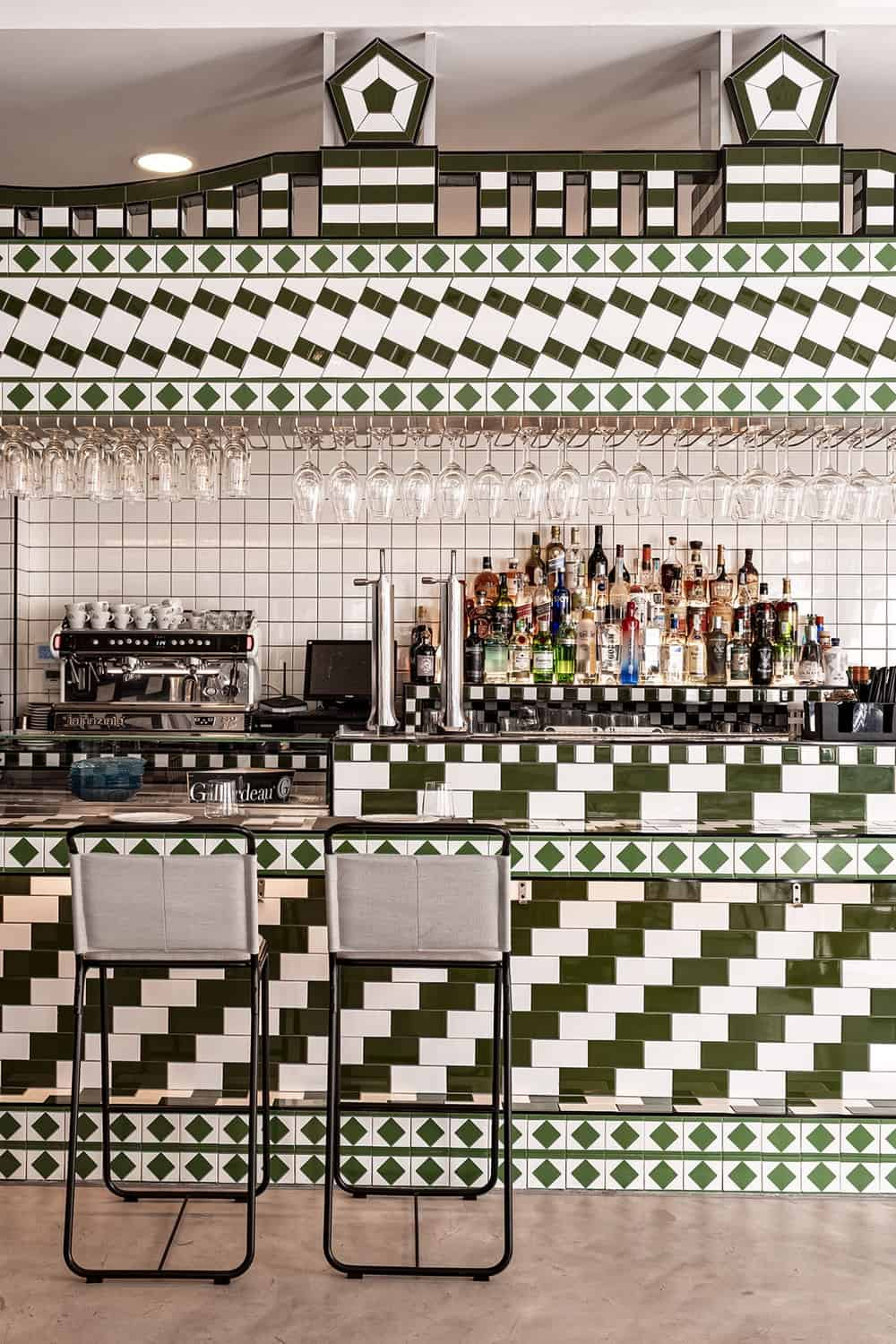 This is a closer view of the bar and its view of the kitchen topped with green checkered to match the bar.