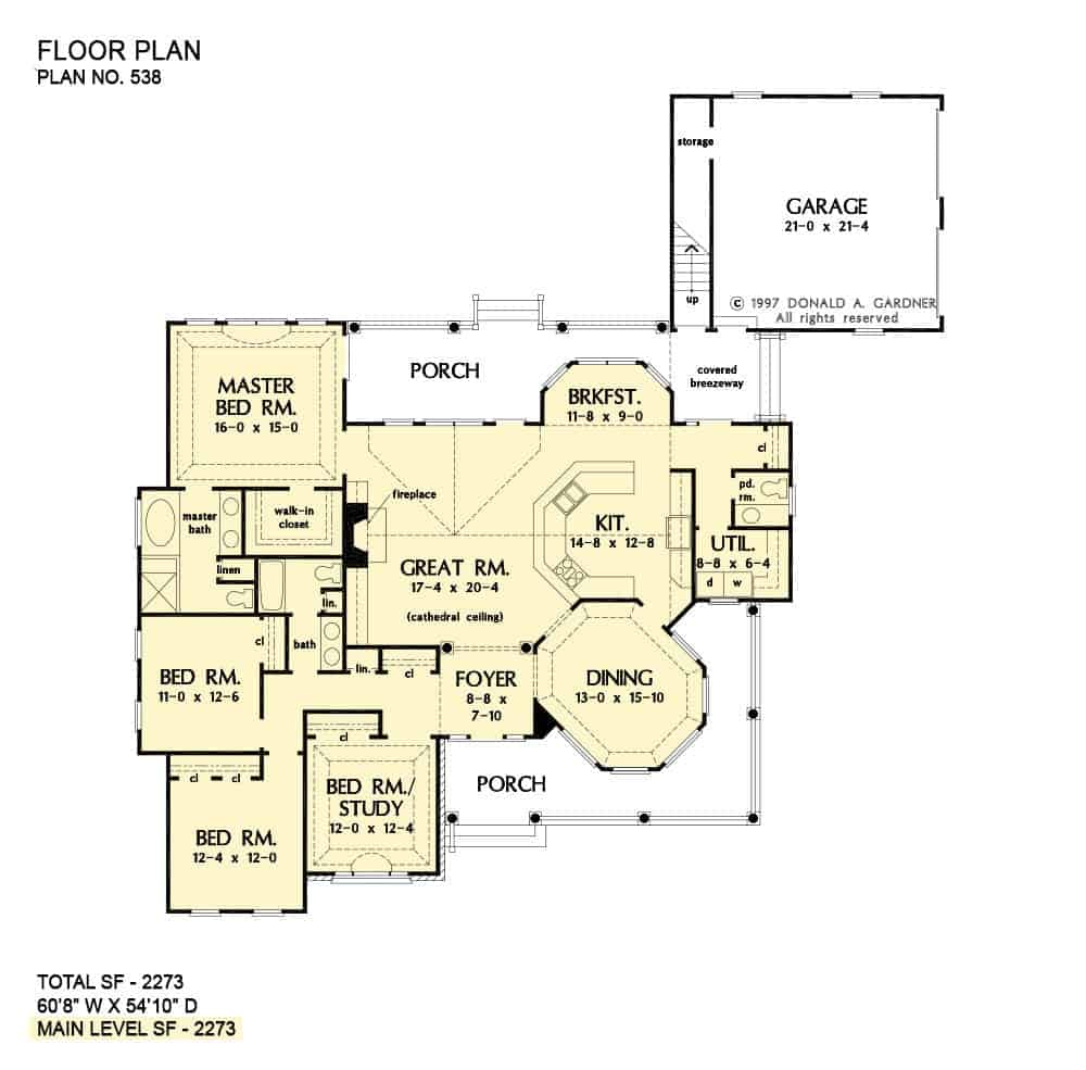 Main level floor plan of a 4-bedroom single-story The Wisteria traditional home with foyer, great room, kitchen with breakfast nook, dining area, utility room, four bedrooms, and expansive covered porches.