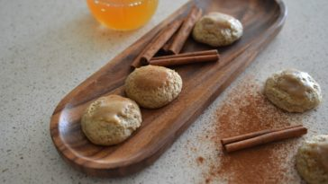 Apple cider cookies garnished with cinnamon sticks.