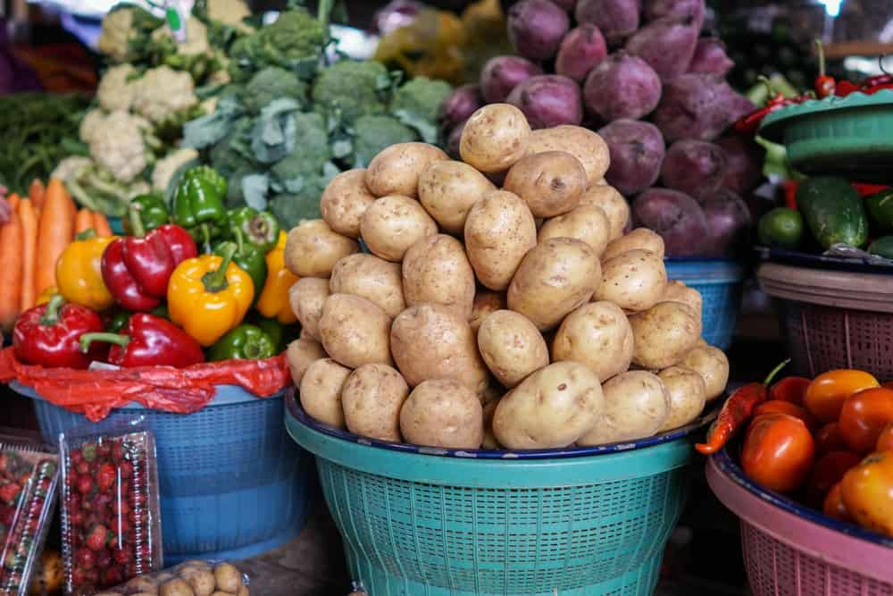 Vegetables and fruits on display at a market.