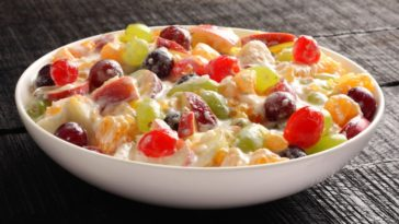 A bowl of creamy fruit salad.