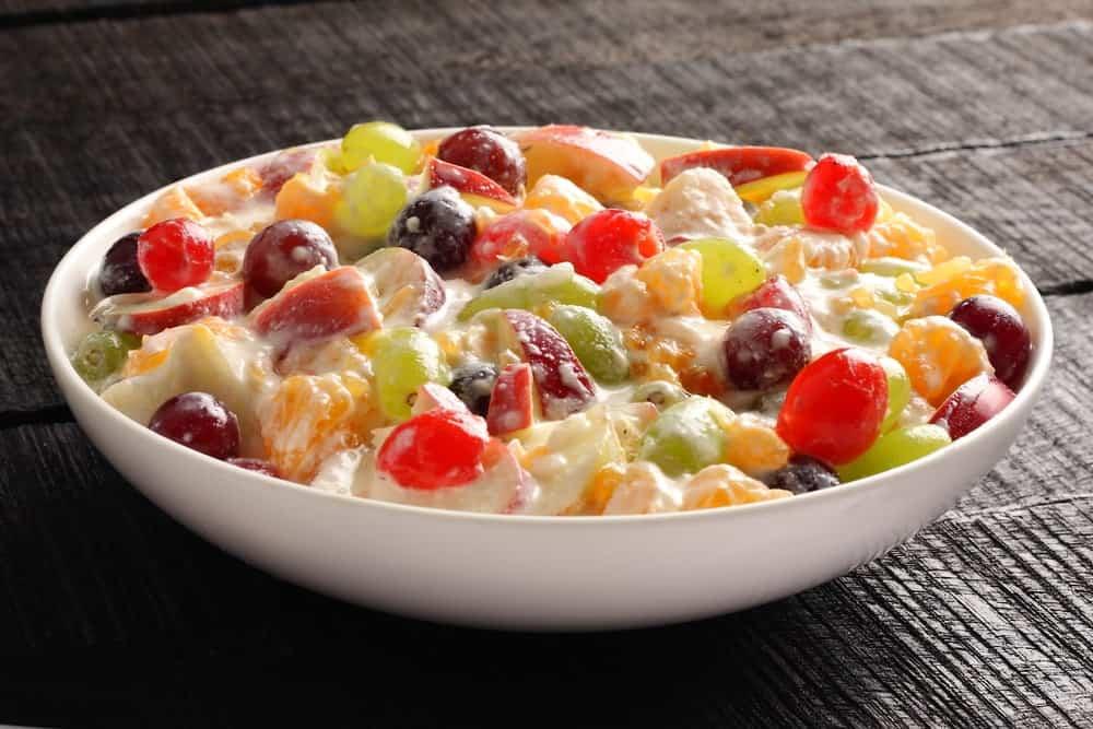 A bowl of creamy fruit salad.