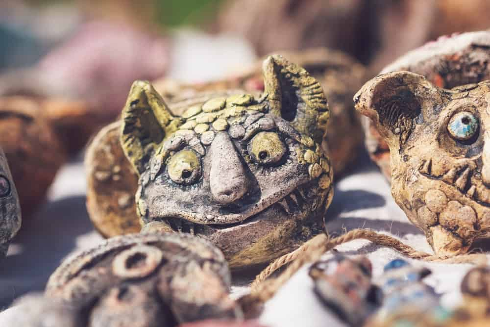 A close look at figurines of monster heads.