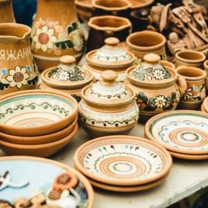 Various clay earthenware on display at a store.