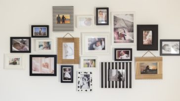 A wall adorned with various floating frames.
