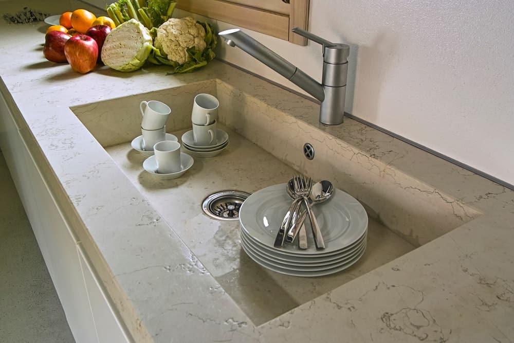 A wide flush mount kitchen sink.