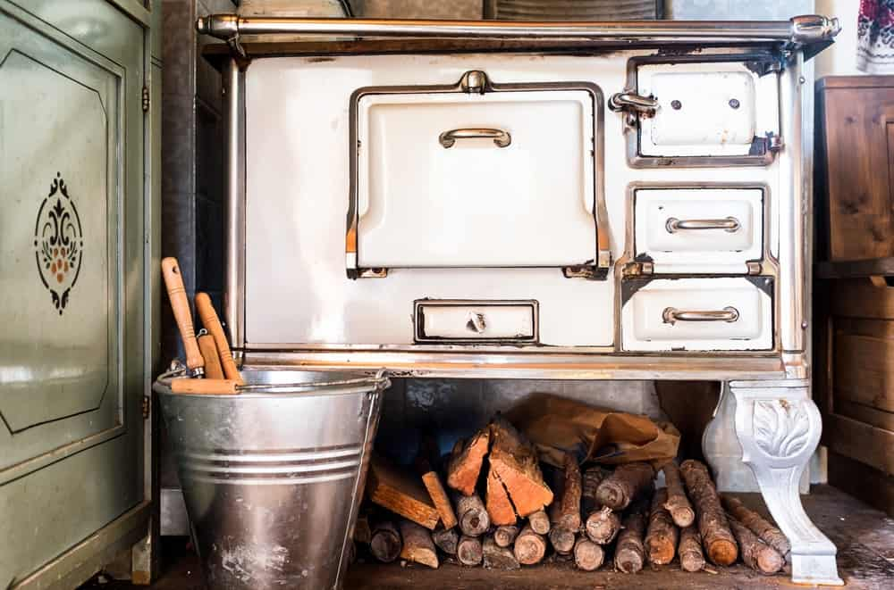 This is an old oven inside a rustic kitchen.