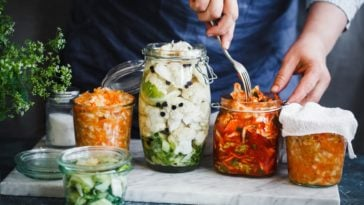A close look at various fermented vegetables in jars.