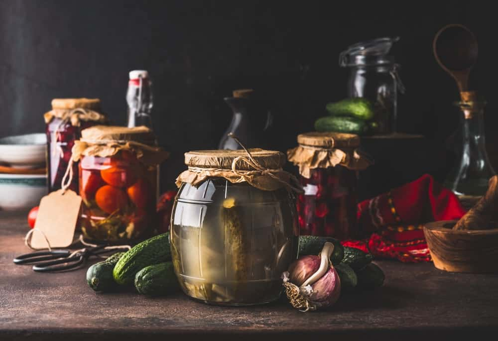 Various vegetables in jars fermenting.