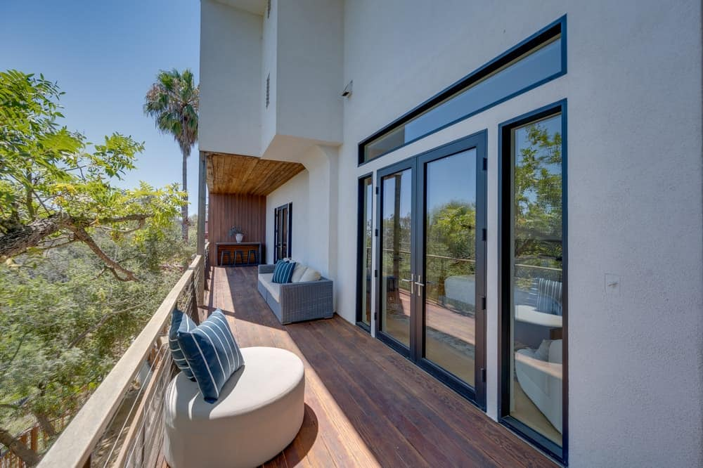 The large balcony outside the bedroom is fitted with comfortable outdoor sitting areas to maximize the view. Image courtesy of Toptenrealestatedeals.com.
