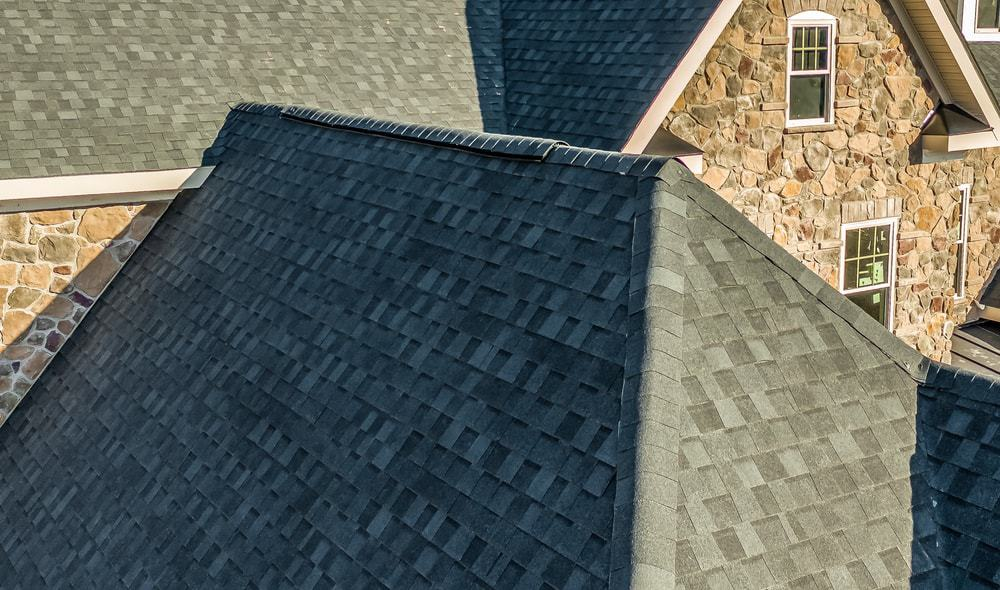A close look at a modern asphalt hip and valley roof.