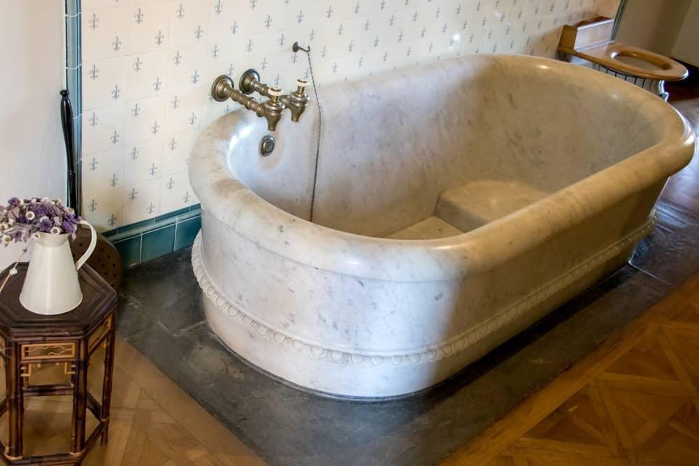 A look at an old marble bathtub.
