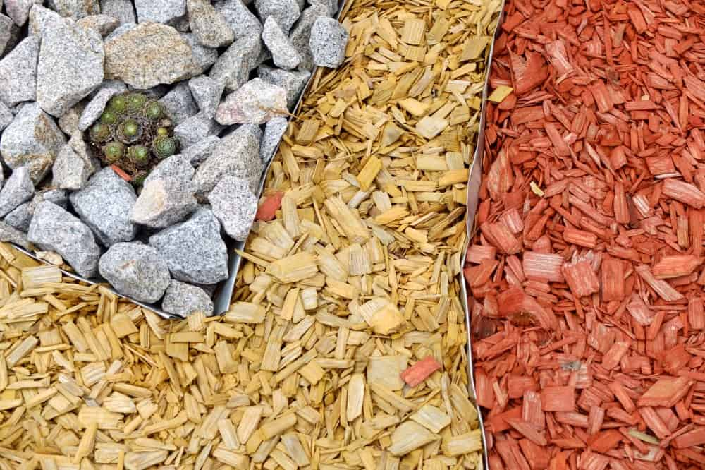A close look at a colorful landscaping with bark mulch.