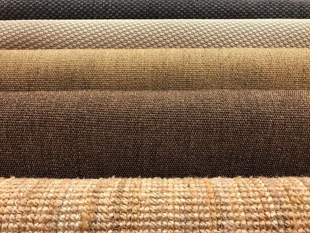 Samples of various carpets on display.