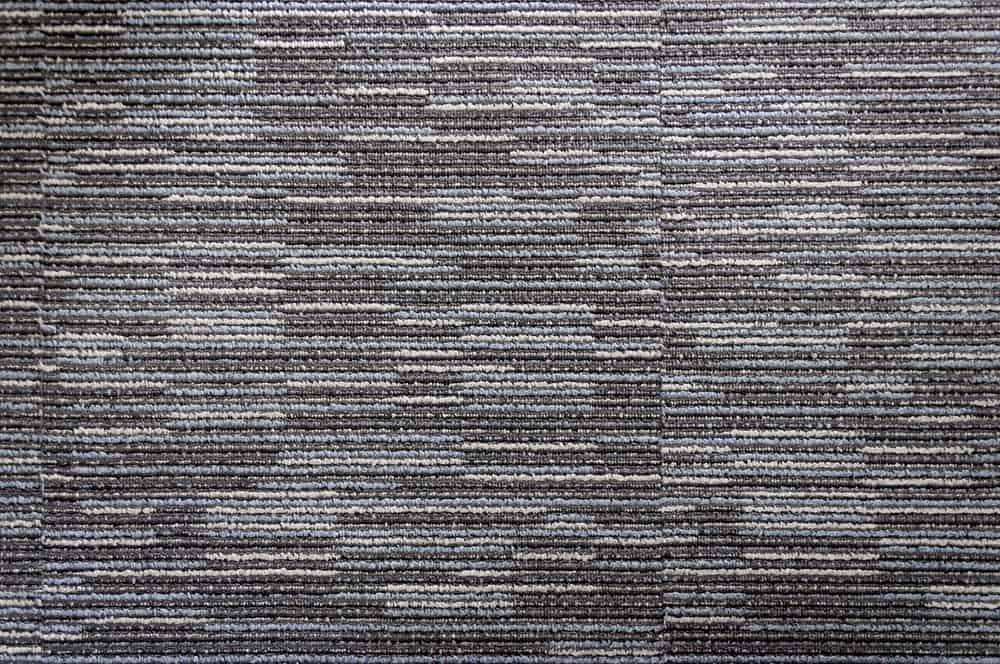 A close look at a carpet with both loop and cut pile.