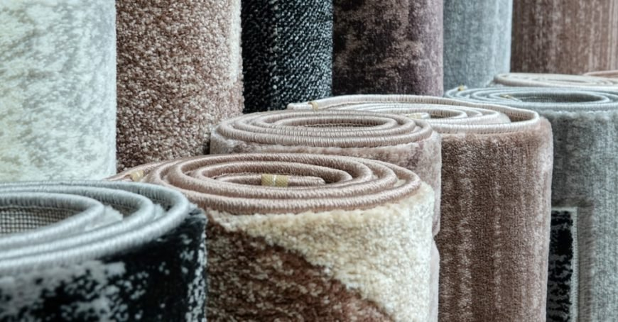 A variety of rolled carpets on display at a store.