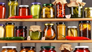 Open shelves with jars of preserved food.