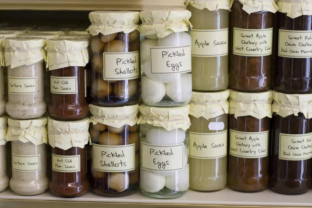 A shelf filled with jars of preserved food.