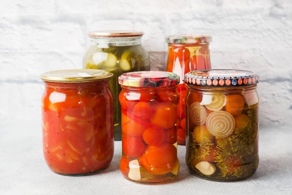 Various preserved vegetables in airtight jars.