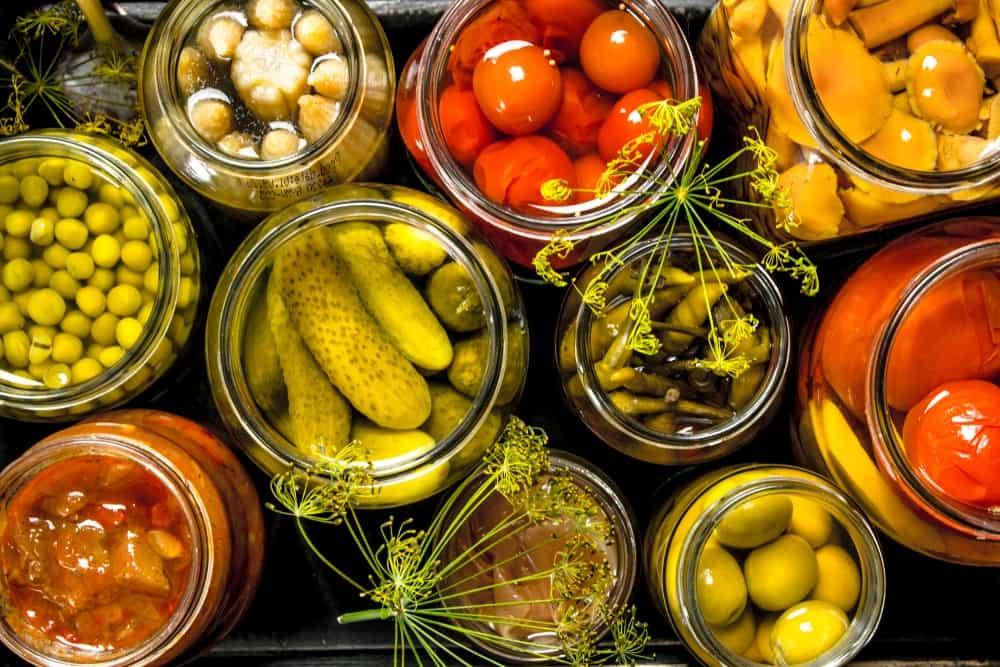 Various vegetables preserved in jars.