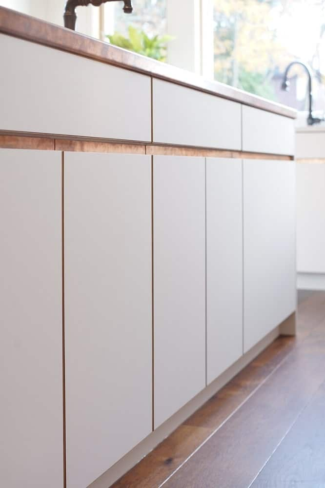 This is the cabinetry of the kicthen island that matches with the modern cabinetry of the rest of the kitchen.
