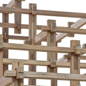 A close look at various pieces of wooden beams joined together with joints.