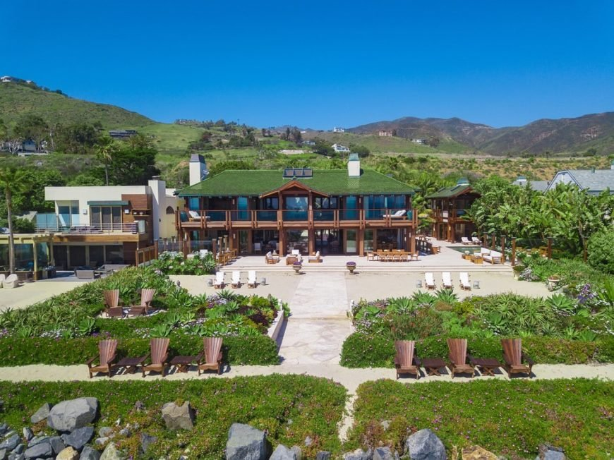 This is the aerial view of the beach home comp[ound with large viewing decks facing the ocean and large outdoor areas leading to the ocean adorned with lush landscaping. Image courtesy of Toptenrealestatedeals.com.