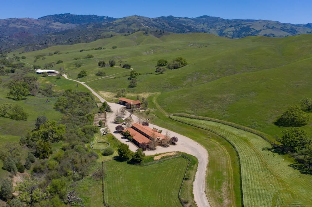 This is an aerial view of the large barn and equestrian center with wide concrete driveways. Image courtesy of Toptenrealestatedeals.com.