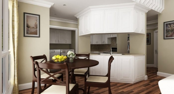 The eat-in kitchen is equipped with a round dining set, white cabinetry, and plenty of counter space.