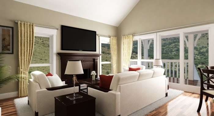 Living room with white seats, large windows, and a fireplace fitted under the wall-mounted TV.