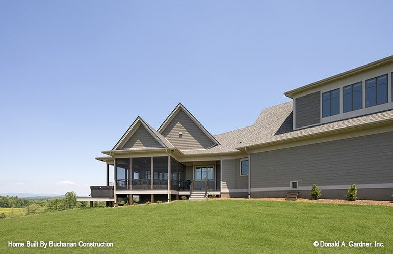 Side exterior view showing the screened porch topped with twin gables.