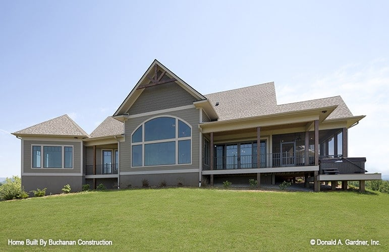 Rear exterior view with covered porches and an arched clerestory window that brings natural light to the great room.
