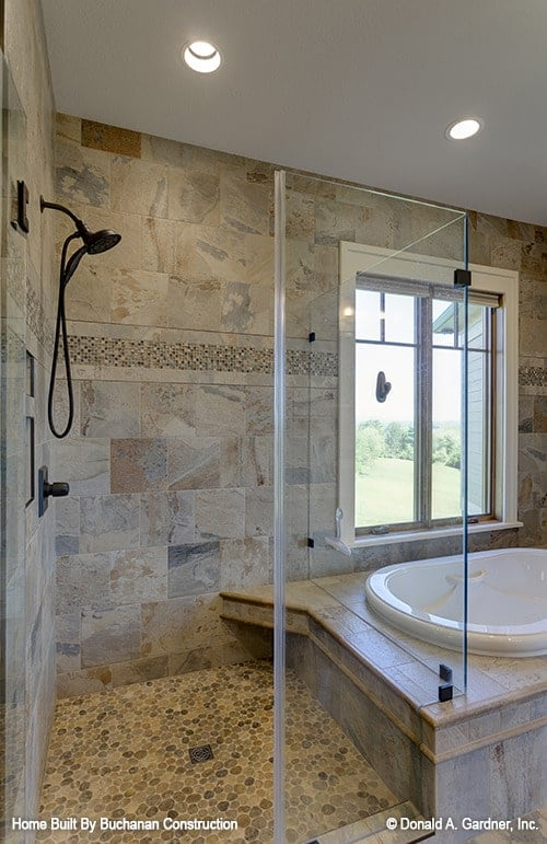 A drop-in bathtub attached to the walk-in shower completes the primary bathroom.