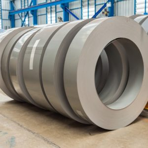 Large rolls of silicon steel at a warehouse.