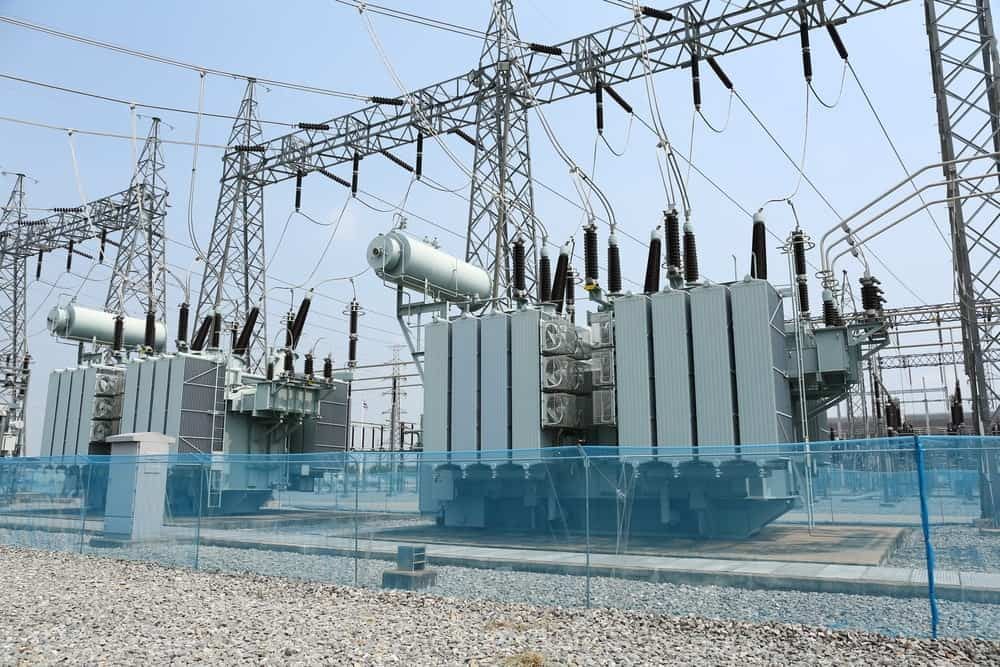A look at a high voltage power station with transformers.
