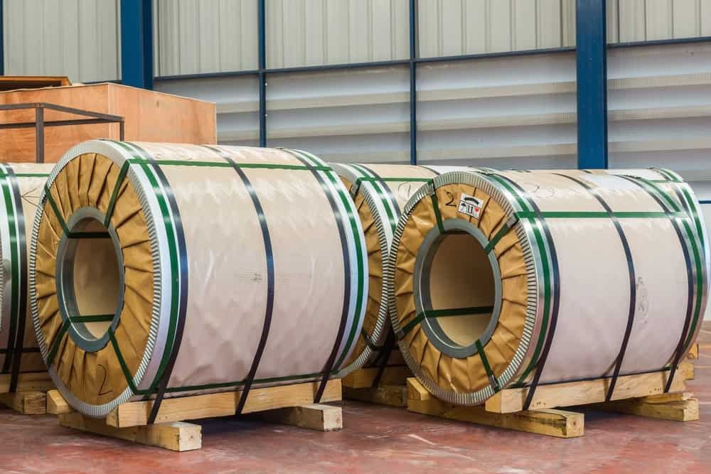 CRGO or silicon steel coils in storage at a warehouse.