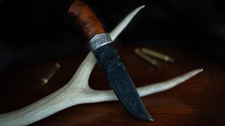 A close look at a trapper knife with a detailed sheath.