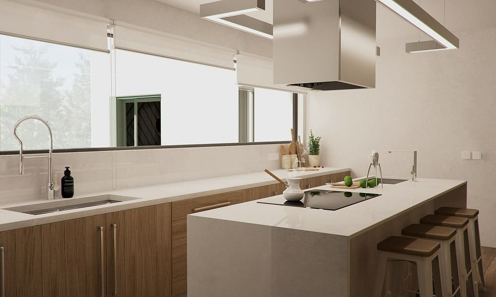 Across from the kitchen island is another set of cabinetry that houses the sink area topped iwth a window to the living room area.