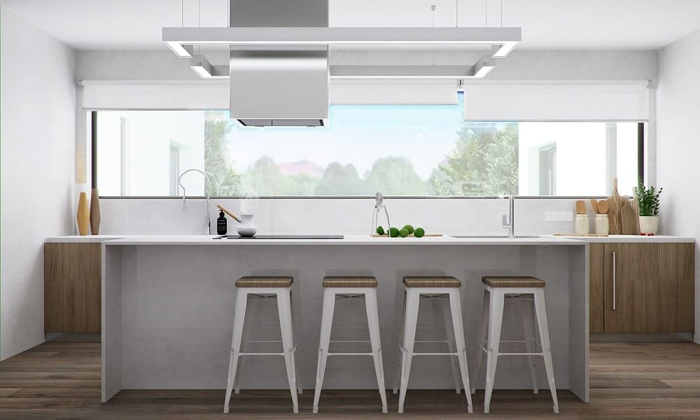 This is a look at the breakfast bar on the other side of the sink area paired with white stools with wooden seats.