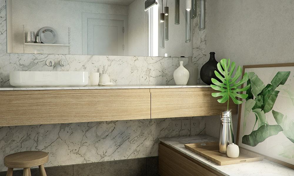 This is a close look at the powder room with a floating wooden vanity that stands out against the white marble wall.