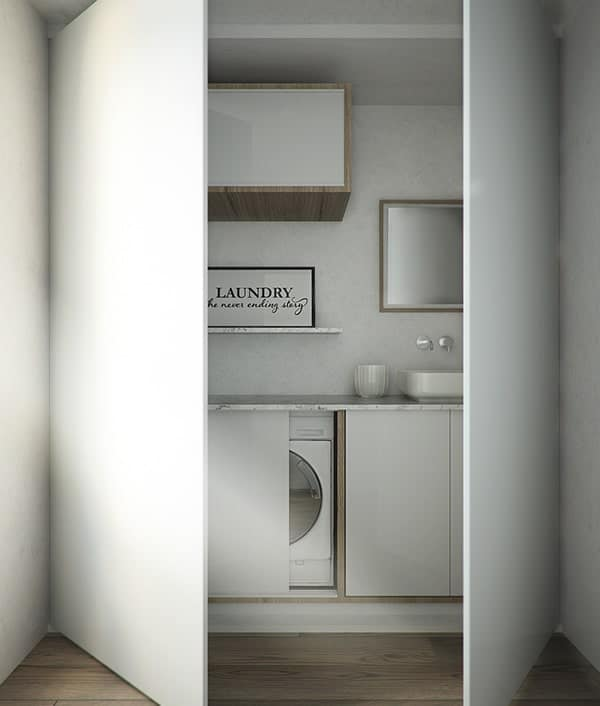 This laundry area can be enclosed with a couple of white doors that conceal it completely.