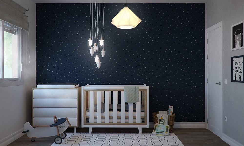 This is the wall of the crib with decorative stars lighting and decoration on the night-like wall.