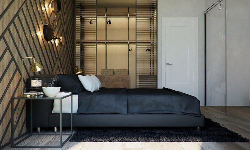 On the side of the large bed is a large closet with its own lighting and structures for storing clothes.