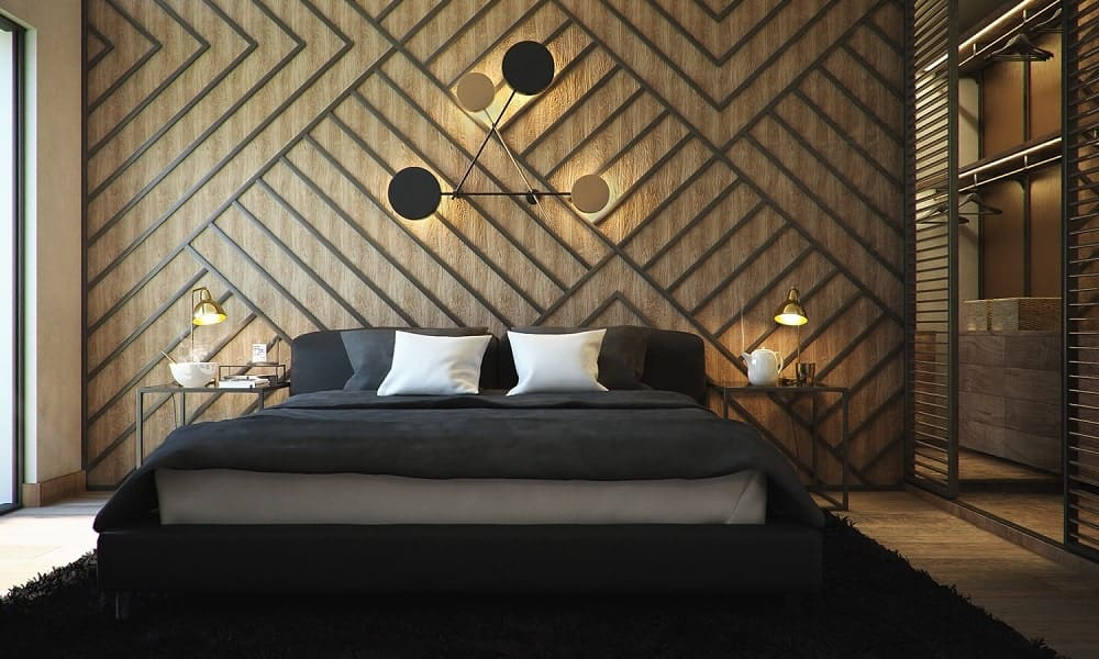 This bedroom has a large patterned wall behind the headboard of the bed adorned with decorative lights and bedside lamps.