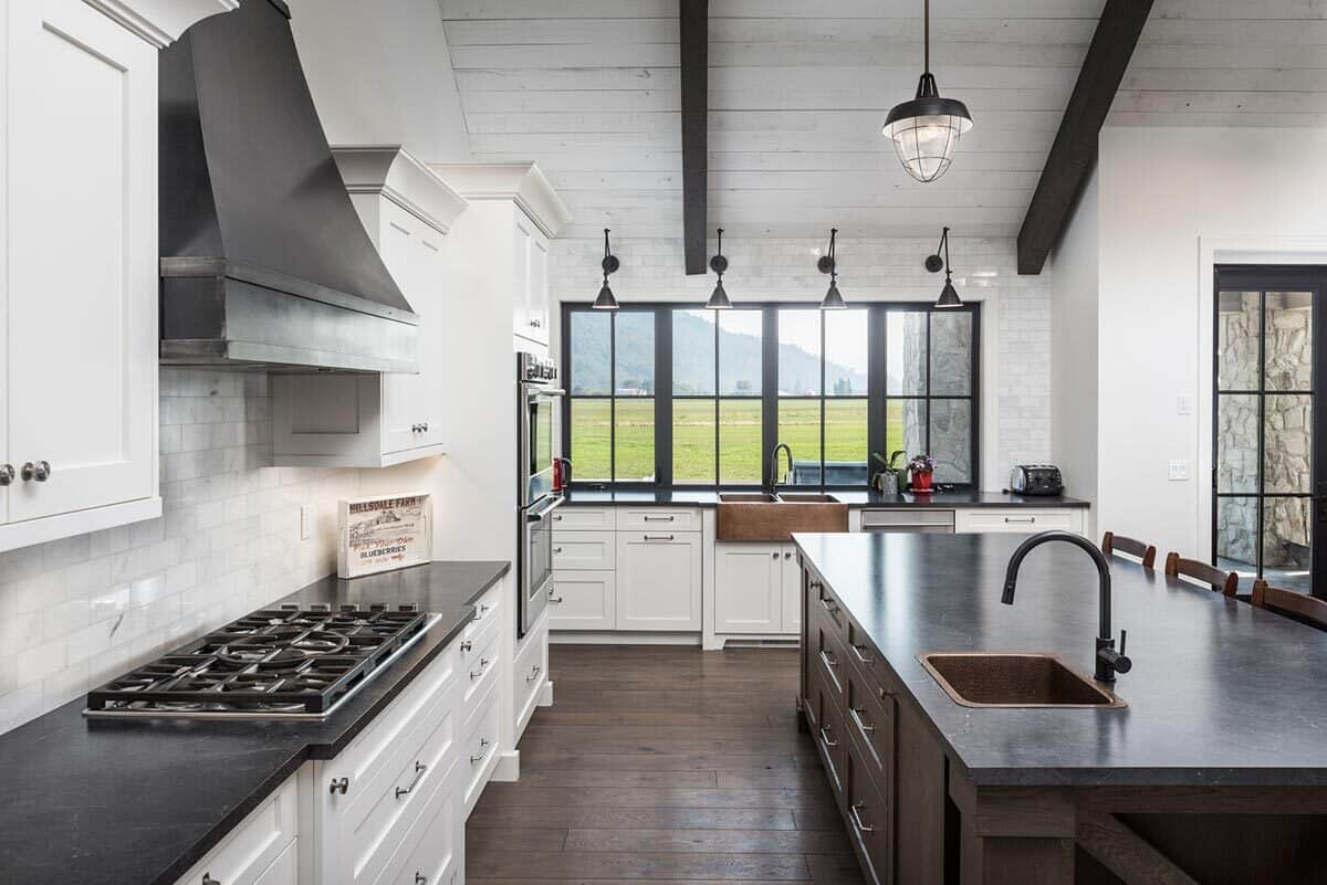 Aluminum framed windows above the sink bring ample natural light in.