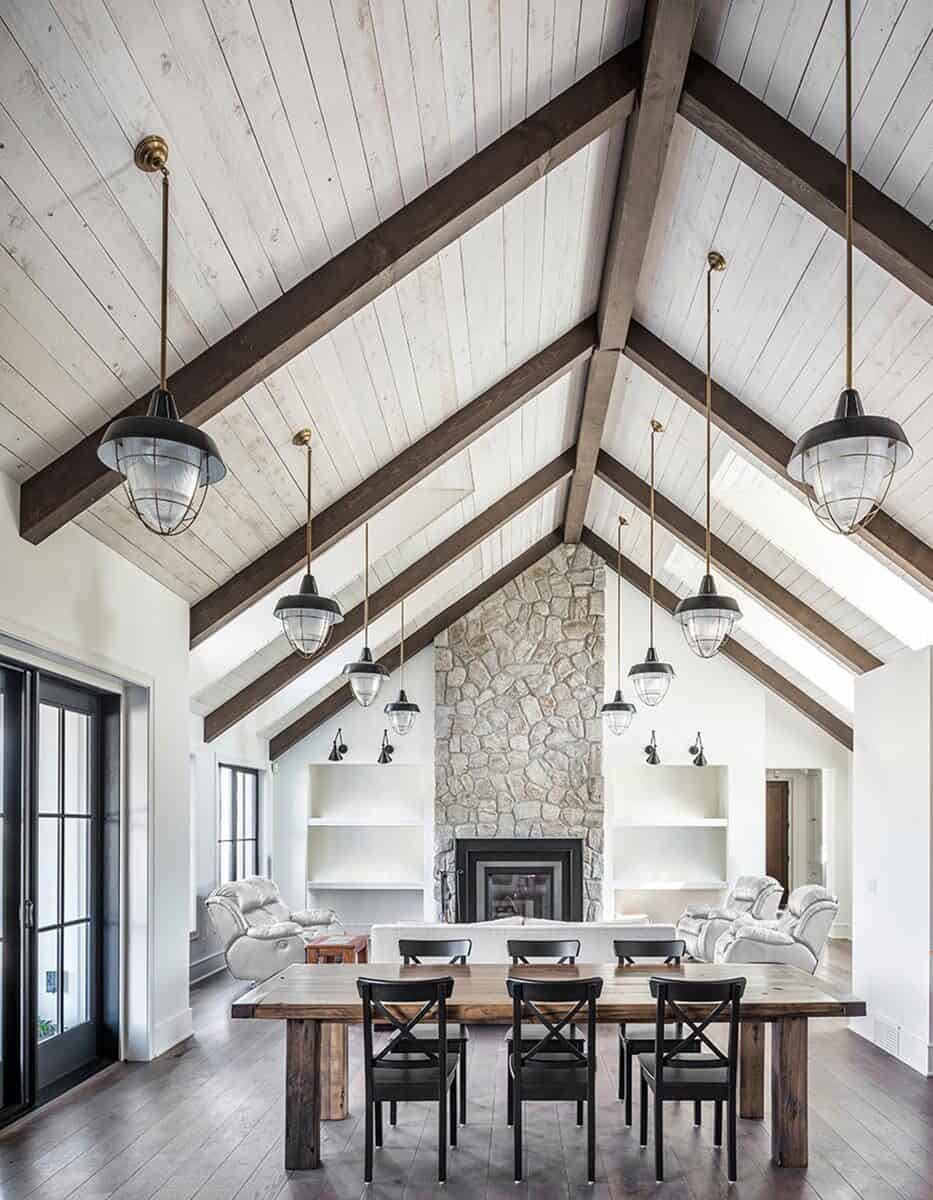 The dining area offers a large wooden dining table and black chairs.