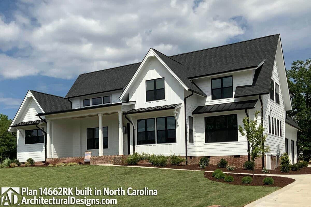 This home has a horizontal and vertical lap siding, brick bases, and tinted glass windows.