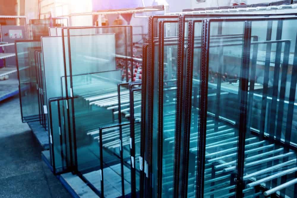 A look at stacks of different insulated glass panels on display at a store.
