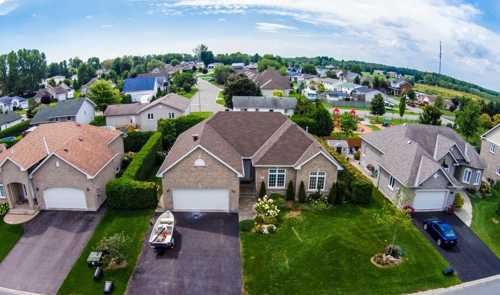 This is a na aerial view of a residential neighborhood with separate lots.